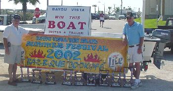 Trophies & boat to give away.
